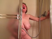 Mature woman has strenuous climax with the douche head