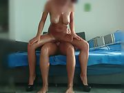 Busty amateur sliding up and down manmeat